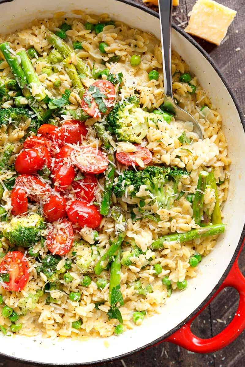 One Pot Orzo Primavera is full of green vegetables and a beautiful sauce with a hint of cream, garlic and lemon! All cooked in the one pan! | https://cafedelites.com