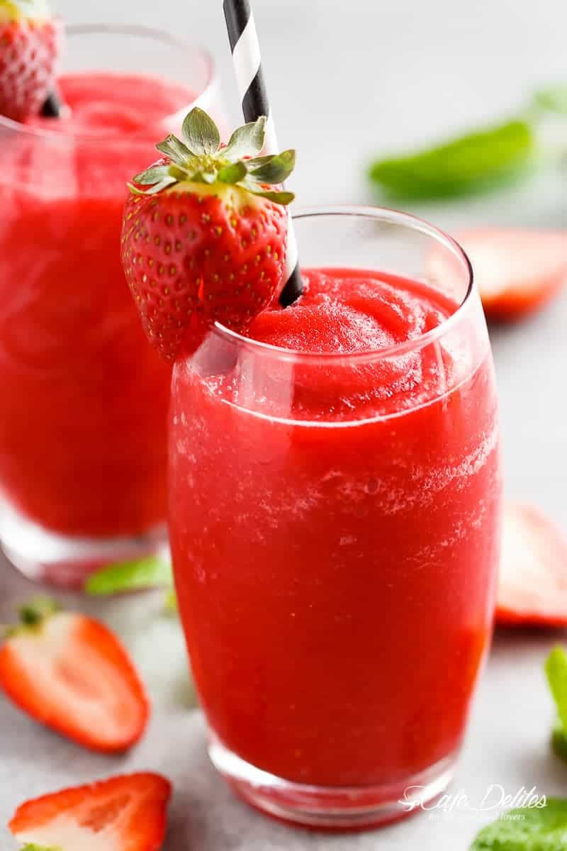 Strawberry Rosé Slushies is THE best way to BEAT THE HEAT! If you love a great drink, this 2-ingredient slushy is for you! | https://cafedelites.com