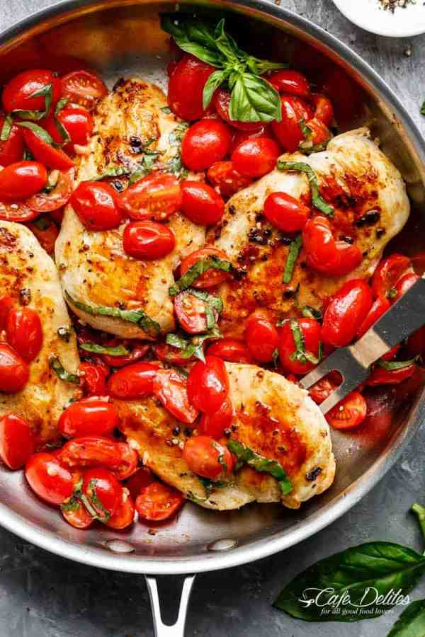 Grape tomatoes burst and cook through a buttery garlic sauce in the Garlic Tomato Basil Chicken recipe! Dinner on the table in minutes! | https://cafedelites./com