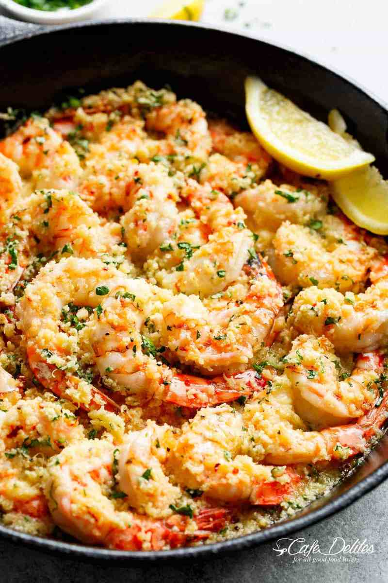 Oven baked shrimp with a hint of lemon and garlic, topped with flavourful golden and buttery, garlic parmesan breadcrumbs. This Crispy Baked Shrimp Scampi is easy to make with a fancy restaurant flair right at home, and takes only minutes to prepare! | cafedelites.com