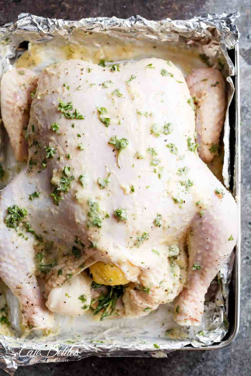 Roast chicken with garlic butter, rosemary, parsley, lemon, and a hint of white wine for an unbeatable flavour. | cafedelites.com
