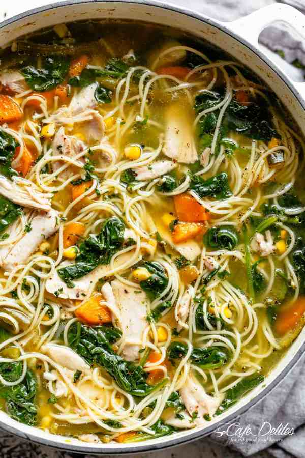 Homemade Chicken Noodle Soup loaded with vegetables with a delicious broth made from scratch! One pot...one soup! Perfect for any day of the week with the broth AND the soup made from scratch in under 45 minutes. You will love this! | cafedelites.com