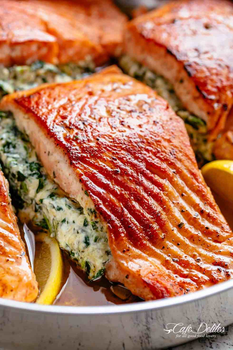 Creamy Spinach Stuffed Salmon is filled with cream cheese, spinach, parmesan cheese and garlic! | cafedelites.com