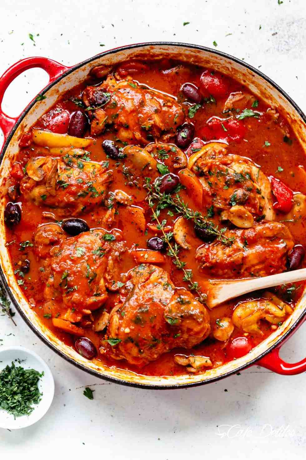 The BEST Chicken Cacciatore in a rich and rustic sauce withchicken falling off the boneis simple Italian comfort foodat its best! Authentic Chicken Cacciatore is an Italian classic, and you'll never get a more succulent home cooked meal than this recipe!Easy to make and loved by the entire family! | cafedelites.com