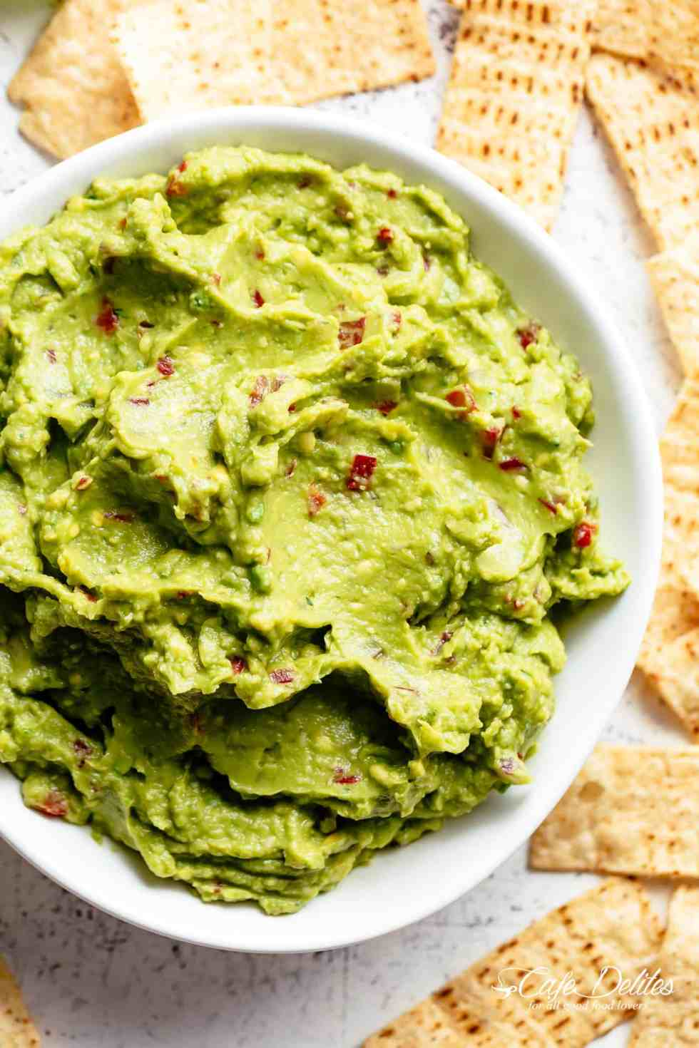 The best, creamy Guacamole is so easy to make and better than anything found in a jar! Homemade Guacamole takes minutes to make and is so incredibly delicious! Perfect for a party as an appetizer OR just a simple snack! Use as a topping for your favourite fajitas, tacos and even carnitas! | cafedelites.com