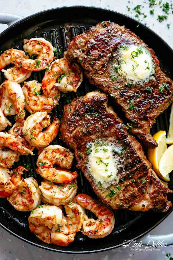Grilled Steak & Shrimp slathered in garlic butter makes for the BEST steak recipe! A gourmet steak dinner that tastes like something out of a restaurant, ready and on the table in less than 15 minutes | cafedelites.com