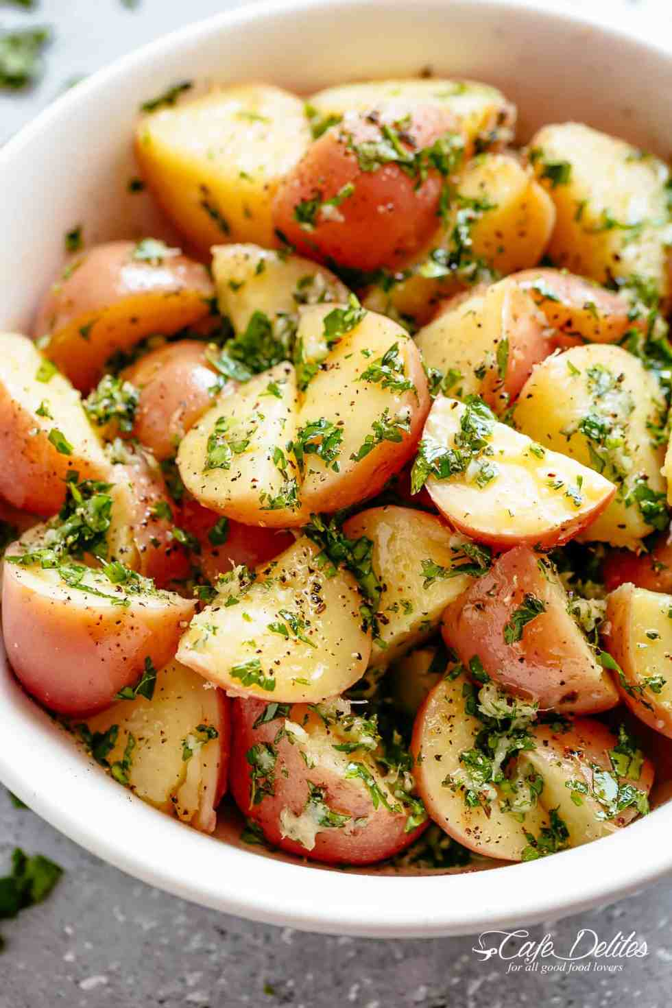 Garlicky Herb Red Potato Salad is ridiculously easy to make and packed with flavour with the most delicious herb dressing! | cafedelites.com