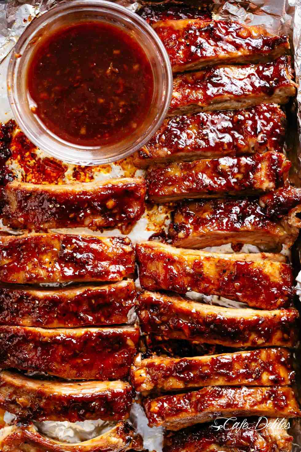 Oven Barbecue Ribsslathered in the most delicious sticky barbecue sauce with a kick of garlic and optional heat! Juicy melt-in-your-mouth oven baked Barbecue Pork Ribs are fall-off-the-bone delicious! Double up on incredible flavour with an easy to make dry rub first, then coat them in a seasoned barbecue sauce mixture so addictive you won't stop at one! Finger licking good ribs right here! | cafedelites.com