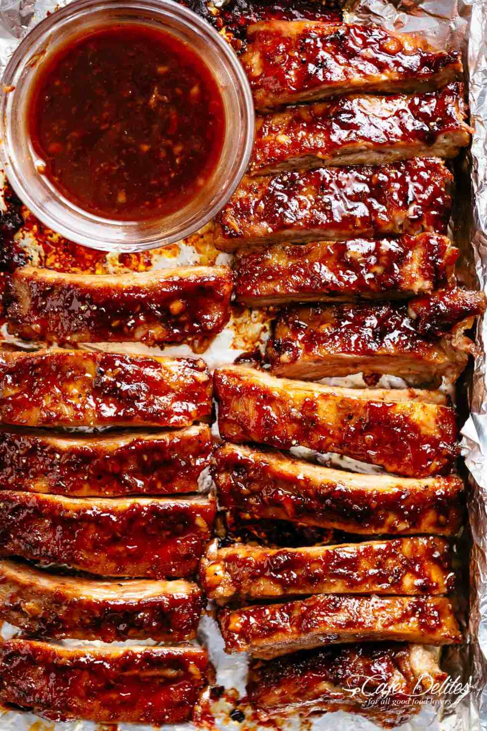 Oven Barbecue Ribs slathered in the most delicious sticky barbecue sauce with a kick of garlic and optional heat! Juicy melt-in-your-mouth oven baked Barbecue Pork Ribs are fall-off-the-bone delicious! Double up on incredible flavour with an easy to make dry rub first, then coat them in a seasoned barbecue sauce mixture so addictive you won't stop at one! Finger licking good ribs right here! | cafedelites.com