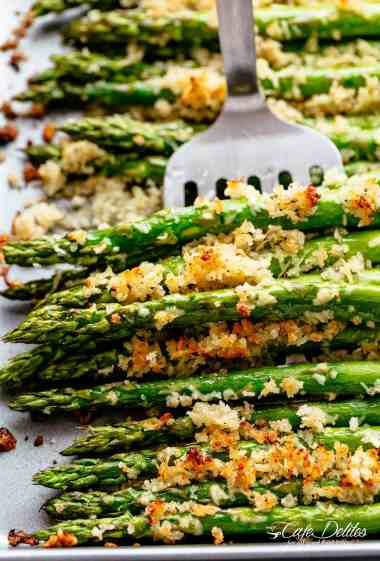 Garlic Butter Asparagus with Crispy Parmesan has so much flavour! The perfect crispy and crunchy side dish OR snack! Topped with a buttery Panko crumb mixture with parmesan cheese and garlic, then roasted and broiled (or grilled) until deliciously crispy with SO MUCH FLAVOUR. Even the pickiest of eaters will LOVE this Asparagus recipe! | cafedelites.com