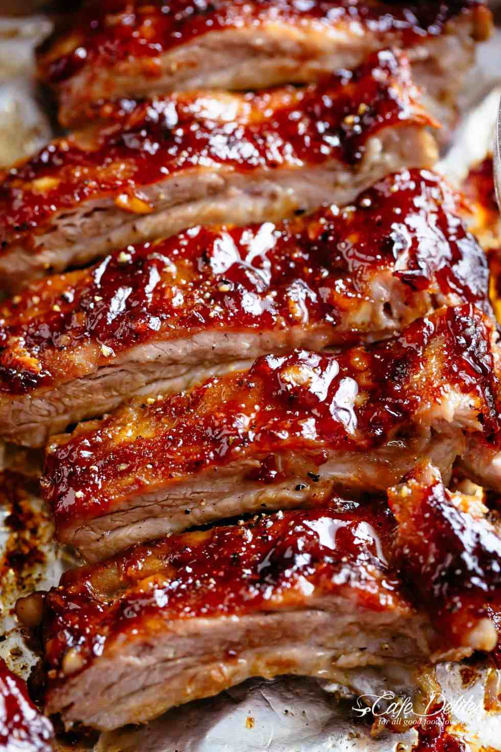 American Ribs Oven Baked and slathered in the most delicious barbecue sauce! | cafedelites.com