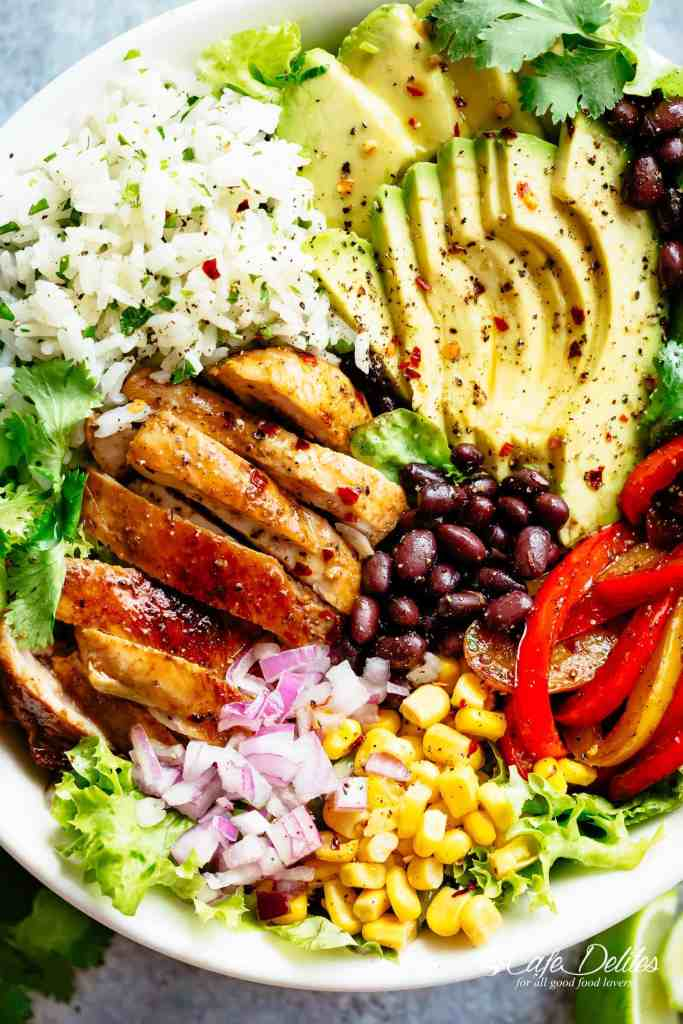 Fajita Chicken Burrito Bowl is packed with juicy golden chicken, cilantro lime rice, avocado and a delicious dressing! Perfect for meal prep! | cafedelites.com