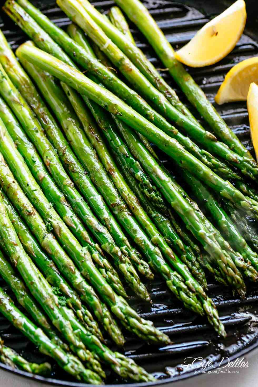 Grilled Asparagus takes minutes! Simply toss in olive oil and garlic, season with salt and pepper and throw them directly on the grill!   cafedelites.com