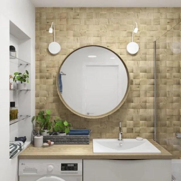 Chiếc máy giặt được kê vừa khít dưới gầm bệ rửa tay, kệ trữ đồ cũng được bố trí gọn gàng riêng một góc tường.