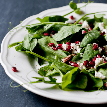 pea shoot chèvre salad with pomegranate