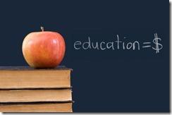 education = $ written on blackboard with apple, books