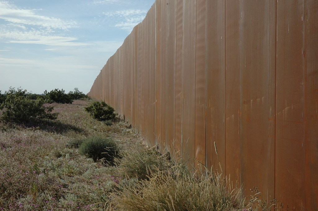 The Wall, US border, separating Mexico from the US, along Highway 2, Sonora Desert, Mexican side. Photo credit: Wonderlane