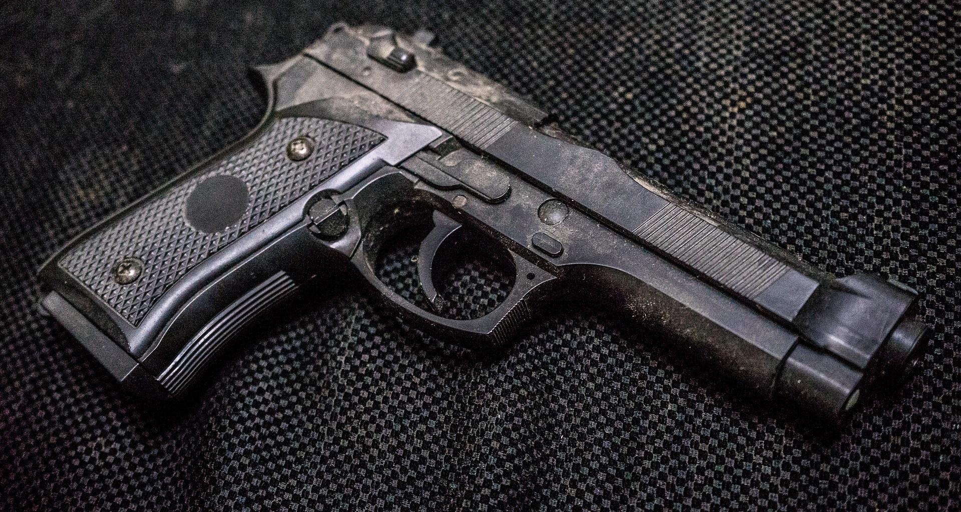 gun on black metal background