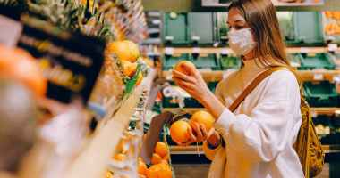 woman wearing mask in supermarket