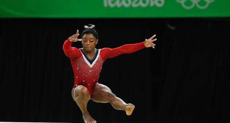 Simone Biles competes on balance beam at the Rio Olympics.