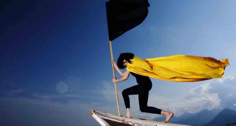 woman holding black flag