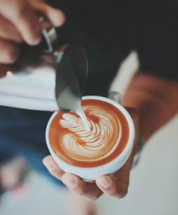 Pexels photo barista creating art on latte