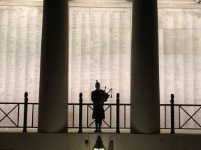 A bagpiper at the Menin Gate.