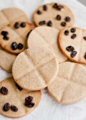 Biscuits with crosses on them and raisins
