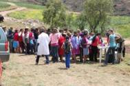 Quechua villagers waiting in line.
