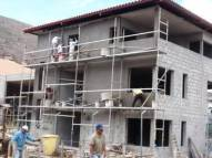 Plastering works on the outside of house 1