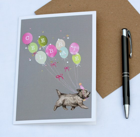 Celebrate card with a cairn terrier carrying balloons