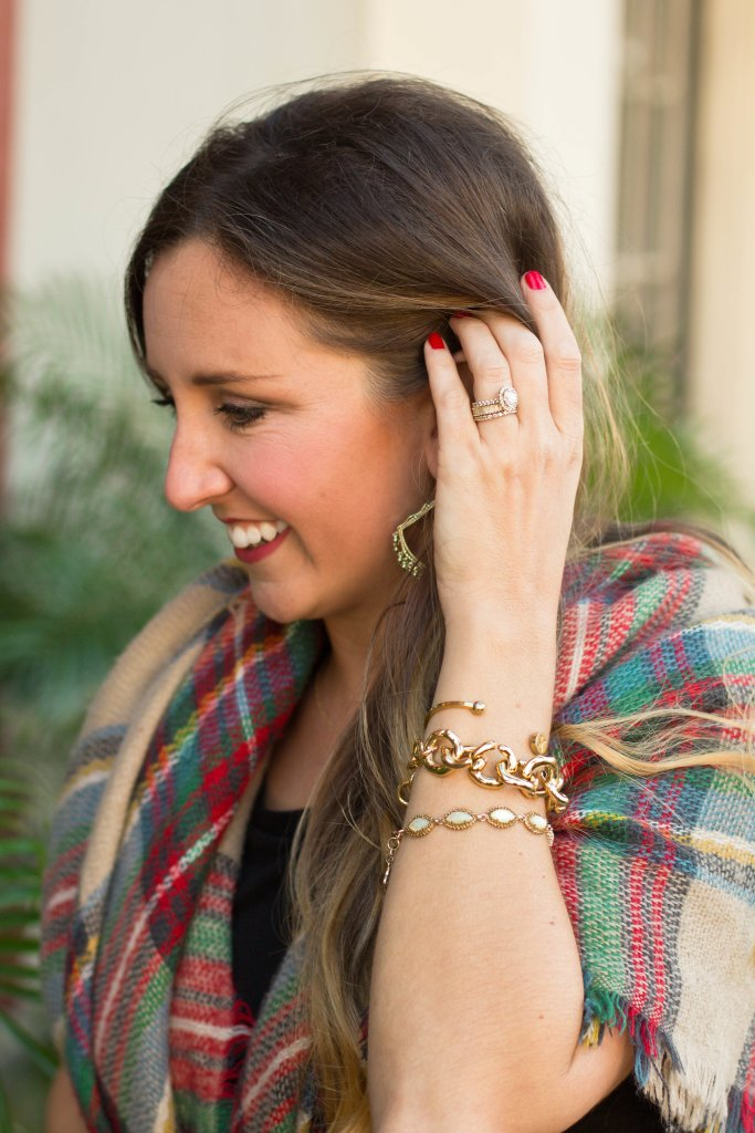 Stacked gold bracelets with classic plaid scarf