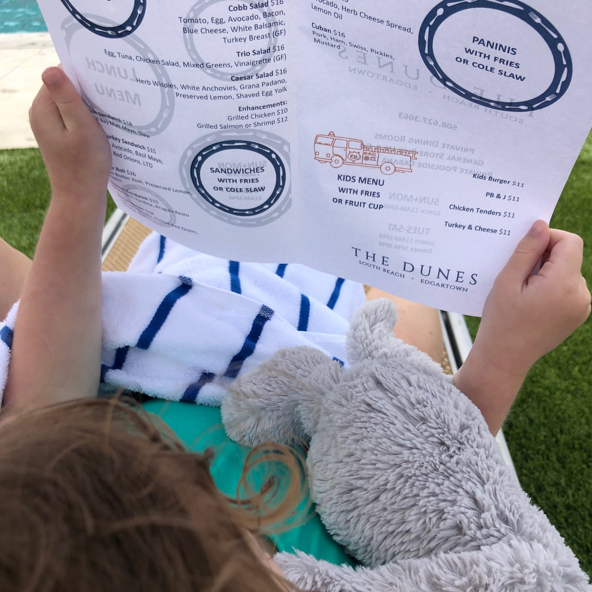 little girl reading poolside grill menu Winnetu Martha's Vineyard