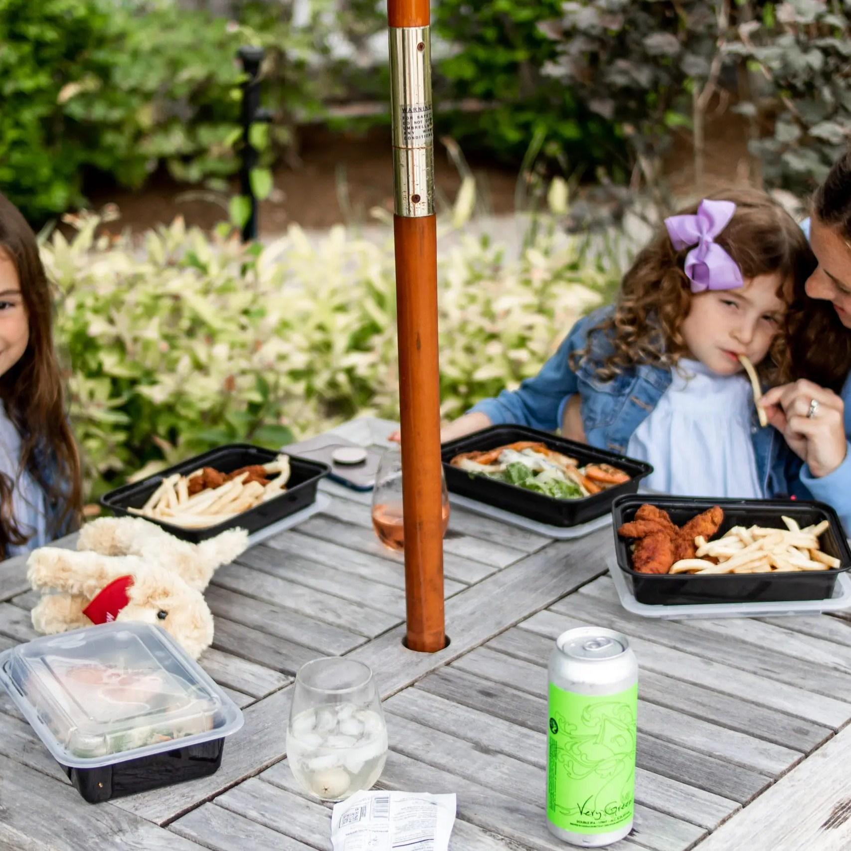 family eating pick up and go dinner at Winnetu
