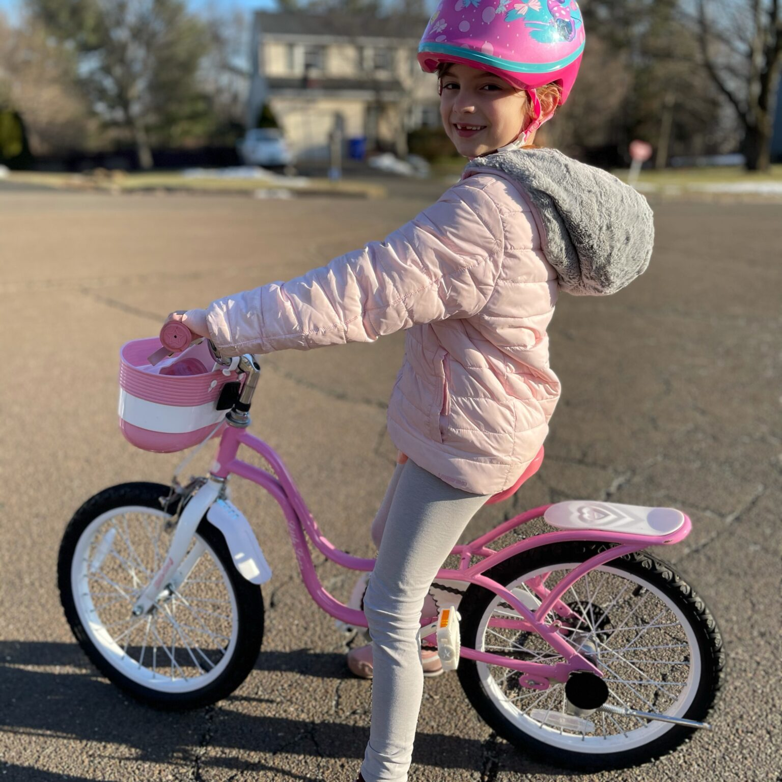 little girl on bike outside