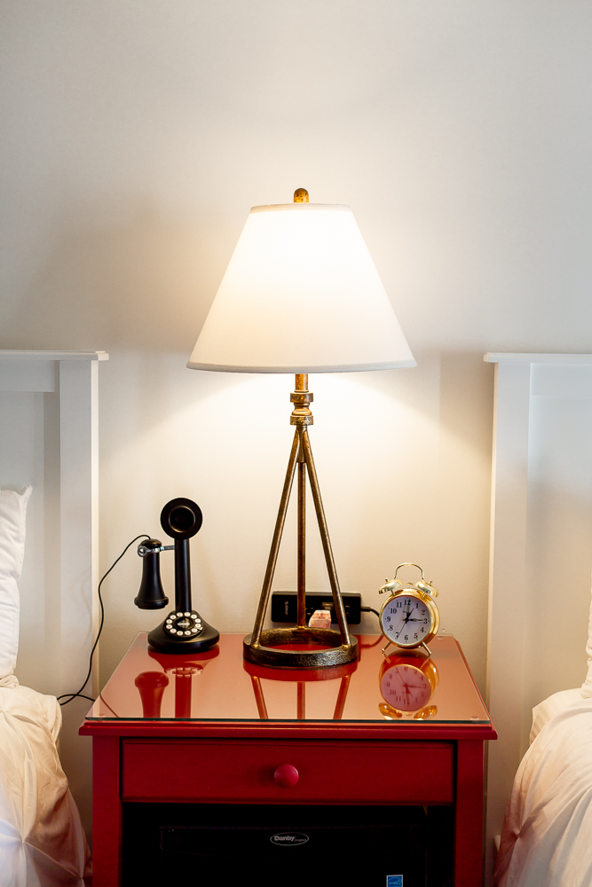 old fashioned phone and red side table Whaler's Inn room decor details