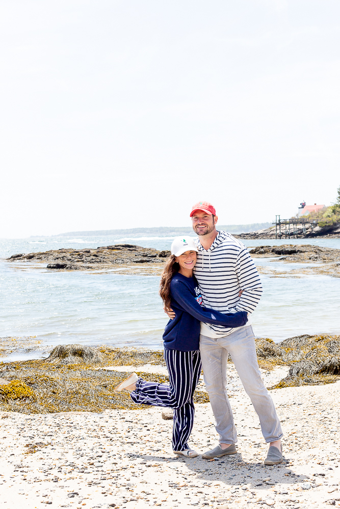couple standing on beach in Maine