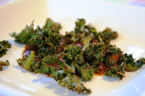 Baked Kale Chips Served on Fire Roasted Tomato Dressing