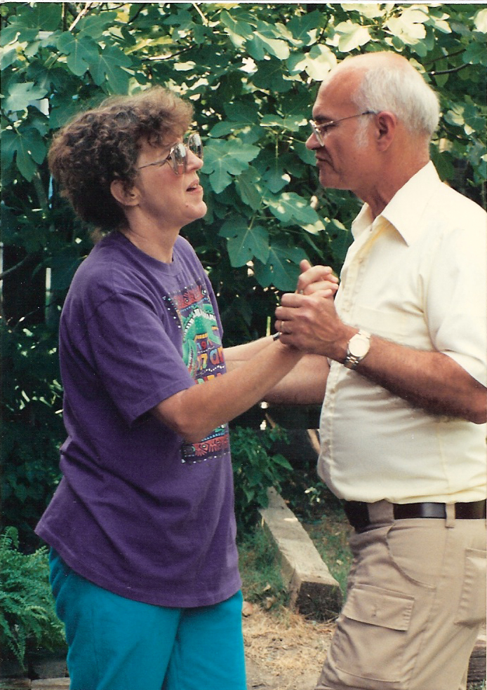 Mom and Dad Boudreaux Cajun dancing next to the fig tree in the back yard