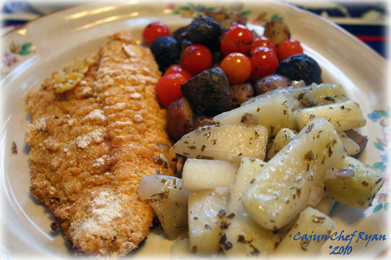 Oven Fried Catfish is served, along with Rockin Herb Roasted Potatoes and Braised Cucumbers