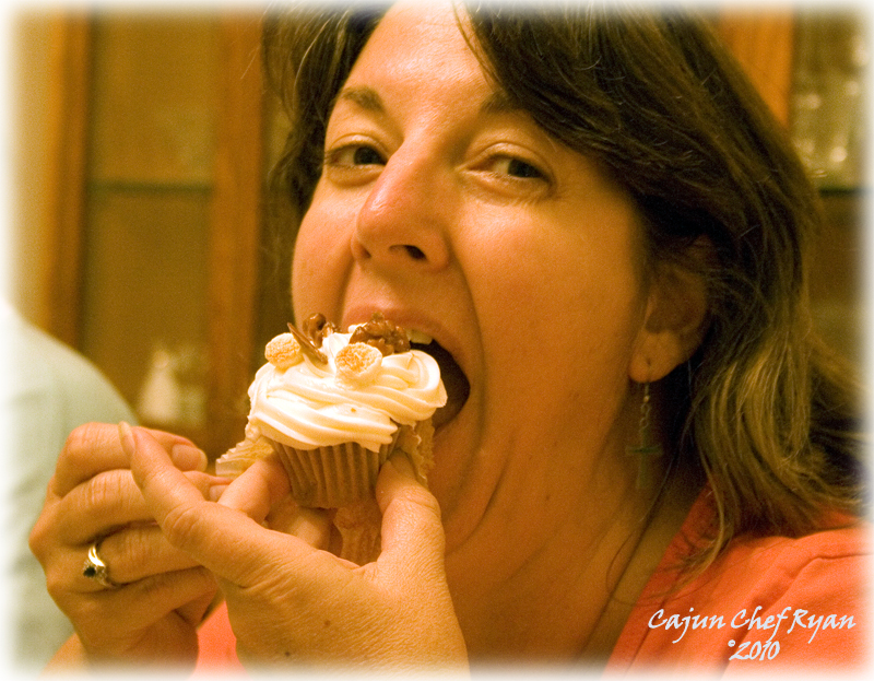 Monique taking her first bite of the Bourbon Sweet Potato Cupcakes.