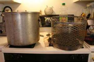 On the stove top 5 gallon pot with basket