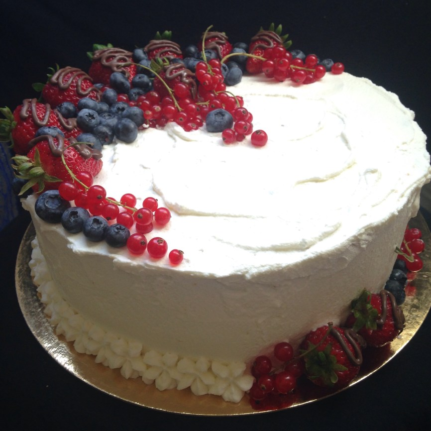 Vanilla sponge cake fresh fruit and whiped ceeam.