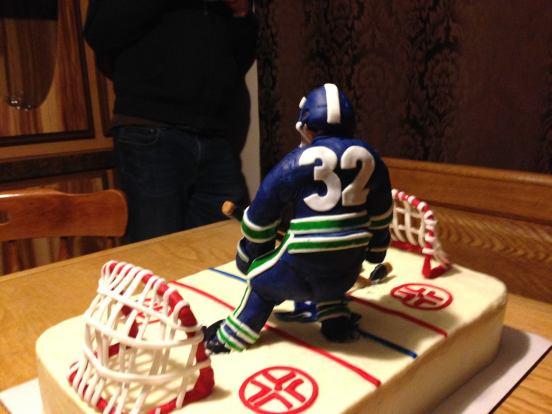 Vanilla raspberry Canucks Hockey cake
