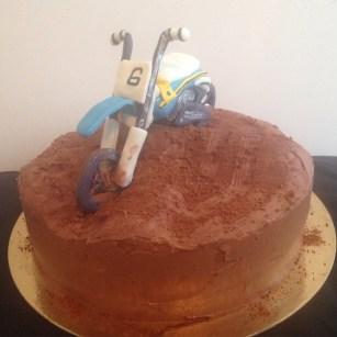 Dirt bike cake, vanilla cream cake with chocolate butter cream icing.