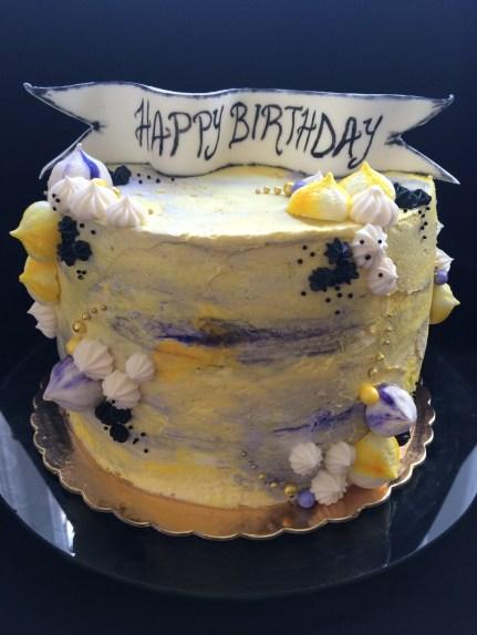 Lemon raspberry cake with lemon curd, raspberries and lemon yellow and purple better cream