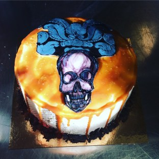 Hand painted skull salted caramel cake