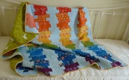 Off-set coin rainbow quilt