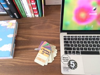 Photo of laptop and writing for web tip cards