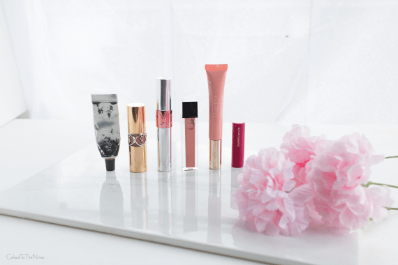 6 moisturizing lip products worth the splurge including YSL Rouge Volupte Shine, Bite Beauty Agave Lip Mask, Bare Minerals Pop of Passion, YSL Oil in Tint, Clarins Instant Light Lip Perfector, Jouer Lip glosses